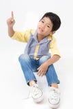 Усаживание мальчика портрета азиатское милое Стоковое Изображение