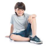усаживание мальчика счастливое Стоковое фото RF