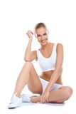 Усаживание нижнего белья красивейшей женщины нося белое Стоковые Изображения RF