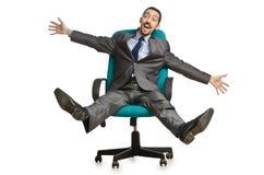 усаживание стула бизнесмена стоковая фотография