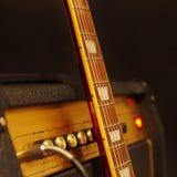 Усилитель для электрической гитары с шеей гитары на черной предпосылке Стоковые Изображения