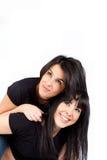 усмедущся 2 женщины молодой стоковое фото rf
