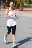 Усмехаться женщины бежать Стоковое фото RF