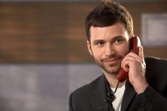 усмехаться звонока бизнесмена Стоковая Фотография