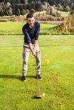 усмехаться игрока гольфа Стоковые Изображения RF