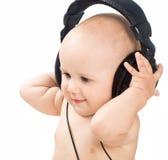 усмехаться наушников младенца Стоковая Фотография
