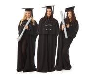 Усмехаться 3 довольно женский студент-выпускников счастливый Стоковые Фотографии RF