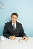 усмехаться офиса бизнесмена Стоковое Фото