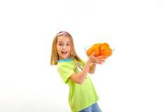 усмехаться померанцев девушки Стоковое Изображение RF