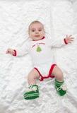Усмехаться ребёнка лежа счастливый Стоковое Фото