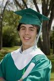 усмехаться студент-выпускника мальчика Стоковые Изображения RF