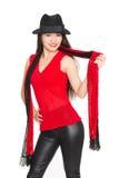 Усмехаясь азиатская девушка с красным шарфом Стоковая Фотография