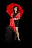 Усмехаясь дама путешествуя с красным зонтиком Стоковая Фотография