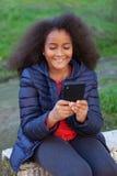 Усмехаясь афро ребенок при чернь принимая фото себя Стоковые Фотографии RF