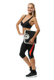 Усмехаясь белокурая женщина держа масштаб веса Фитнес Стоковое фото RF