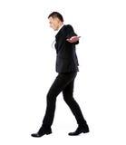 Усмехаясь бизнесмен держа доллары США Стоковое Изображение RF