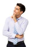 Усмехаясь бизнесмен смотря вверх стоковые изображения rf