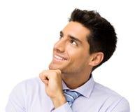 Усмехаясь бизнесмен смотря вверх стоковое фото rf