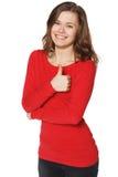 Усмехаясь выставка большого пальца руки женщины поднимающая вверх. Изолированная предпосылка. Стоковое фото RF