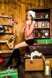 Усмехаясь девушка в украшениях рождества Стоковое Фото