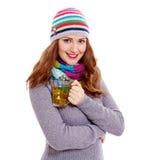 Усмехаясь девушка с чашкой чаю Стоковое Фото