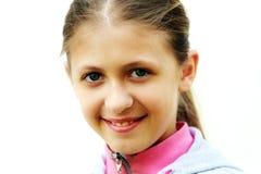 Усмехаясь девушка Стоковое Изображение