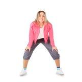 Усмехаясь женщина в sportwear изолированная над белизной Стоковые Фотографии RF