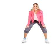 Усмехаясь женщина в sportwear изолированная над белизной Стоковая Фотография