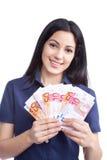 Усмехаясь женщина держа примечание евро Стоковая Фотография