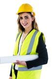 Усмехаясь женщина держа план строительства Стоковая Фотография