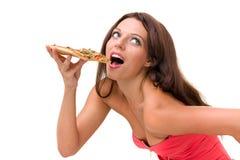 Усмехаясь женщина при большая пицца изолированная на белизне Стоковые Изображения RF