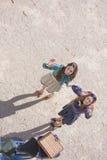 2 усмехаясь женщины смотря камеру сверху Стоковое фото RF
