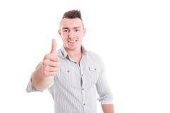 Усмехаясь жест человека показывая как или большого пальца руки-вверх Стоковые Фото