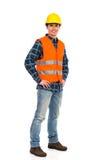 Усмехаясь ждать рабочий-строителя. Стоковое Фото