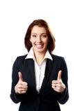 Усмехаясь коммерсантка с большими пальцами руки вверх стоковые фотографии rf