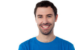 Усмехаясь красивый парень изолированный над белизной Стоковое Изображение RF