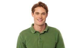 Усмехаясь красивый парень изолированный над белизной Стоковое Фото