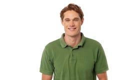 Усмехаясь красивый парень изолированный над белизной Стоковое Изображение