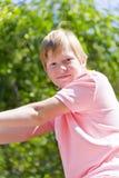 Усмехаясь мальчик в каменном парке Стоковые Изображения RF