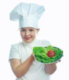 Усмехаясь маленькая девочка в шляпе кашевара Стоковая Фотография RF