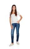 Усмехаясь маленькая девочка с стоять джинсов Стоковое Фото