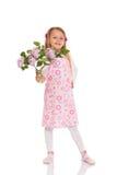 Усмехаясь маленькая девочка с цветками сирени Стоковые Изображения