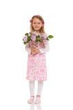 Усмехаясь маленькая девочка с цветками сирени Стоковые Фотографии RF