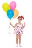 Усмехаясь маленькая девочка с шариками в их руках Стоковая Фотография RF