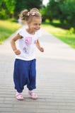 Усмехаясь маленькая девочка Стоковое Фото