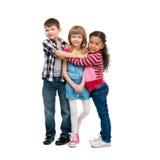3 усмехаясь маленьких дет стоя совместно Стоковые Фото