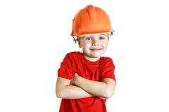 Усмехаясь мальчик в шлеме конструкции Стоковое Изображение