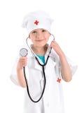 Усмехаясь медсестра детенышей держа стетоскоп стоковое изображение