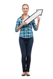 Усмехаясь молодая женщина при стрелка poiting вверх Стоковое Изображение RF
