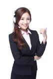 Усмехаясь молодая женщина с наушниками Стоковые Фотографии RF